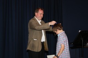 Kieron Winn presenting an award